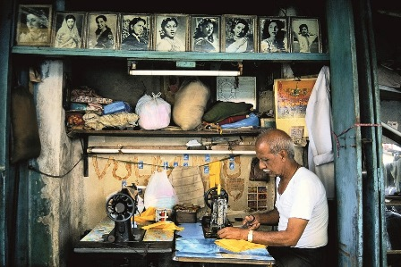 A tailor in Kamatipura in Mumbai works under the watchful eye of Hindi cinema's leading ladies from the black-and-white era