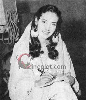 "Costumed as Laila, the youthful Nutan signs autographs for fans who visited the ""Laila Majnu"" set"
