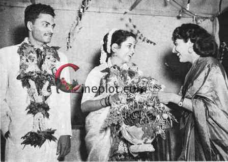 "Usha Kiron – Dr. Kher Wedding Picture (May, 1954) - Shammi (right) ""says"" it with flowers"
